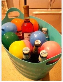 DIY::A colorful way to keep drinks cold during a party. Just freeze balloons filled with water ! Long Lasting and Festive !!
