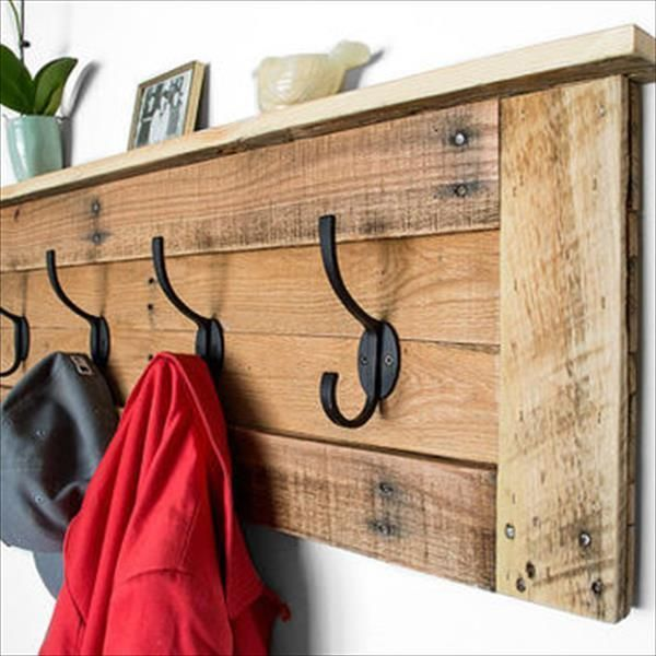 This is a plain Pallet Coat Rack with Hooks and you can make it on any wall of your choice. The rustic look will add beauty to your wall so let it be.