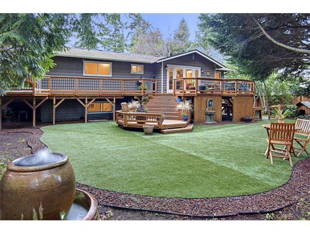 I'd screen in part of the deck.  I like how it runs the length of the house.