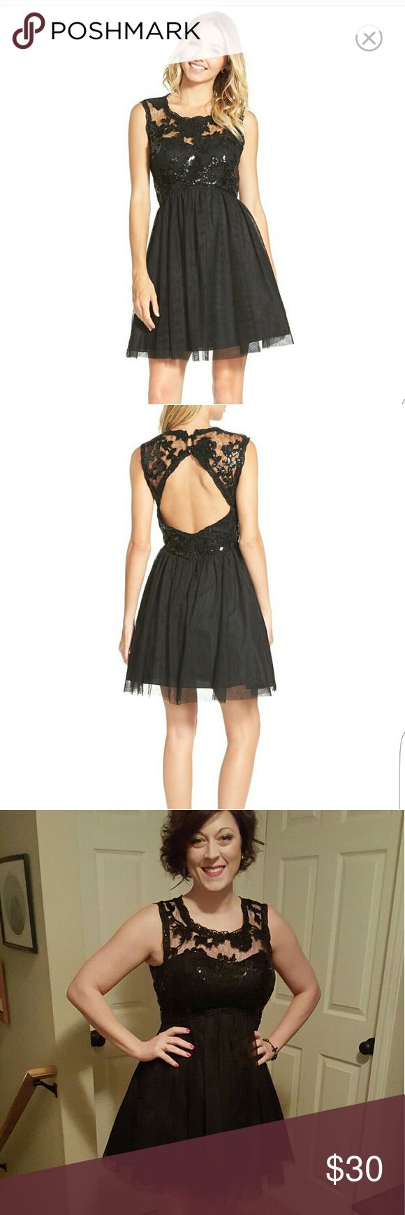 """Little Black Dress/Prom Style Dress Sequined lace with a back cutout makes this tulle-skirted party dress next-level pretty. 34"""" length. Back zip and button-and-loop closure. Scooped neck. 100% polyester. Hand wash cold, dry flat. By Sequin Hearts; imported. Worn Once to a holiday party, excellent condition!  Tag says size 9, I am 5'4, 135 lbs, 36D ish, 30 inch waist. It fits like a 6 or 8 like most of my other dresses. Sequin Hearts Dresses"""