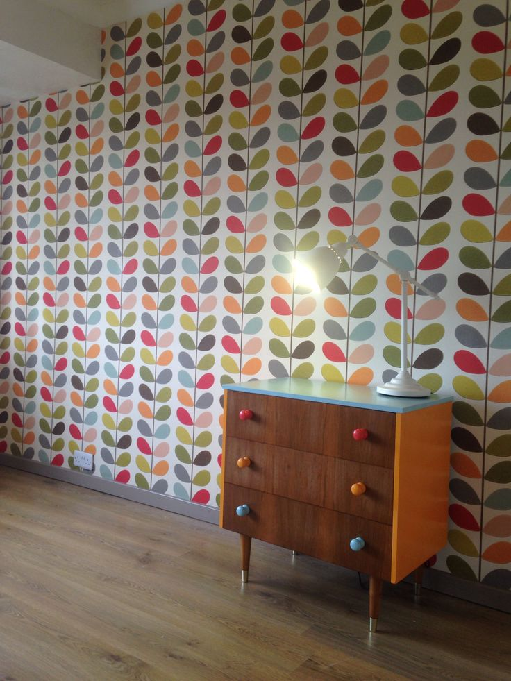 Orla Kiely Multi-stem wallpaper and upcycled drawers.