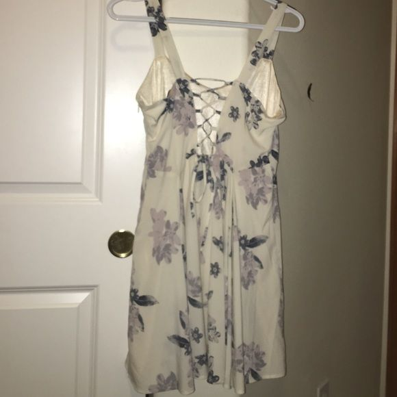 FLORAL DRESS Worn once, now too short for me but it looks AMAZING on... I wish I could keep this haha. The lace up back is a gorgeous detail and the front is not too modest but to too showy at all. Perfect for weddings, parties, just summer days, ect. Make an offer!! I am always willing to negotiate! Urban Outfitters Dresses