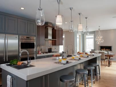 Expansive Kitchen Island With Five Midcentury Pendant Lights