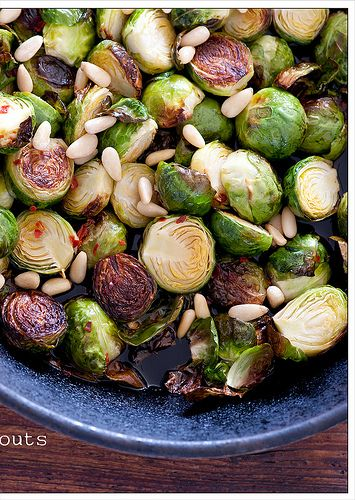 300g (10oz) brussels sprouts      2 tablespoons fish sauce      1 tablespoon sherry vinegar or rice wine vinegar      1/2 teaspoon chilli flakes      small handful pinenuts, optional    1. Preheat oven to 200C (400F). And get an oven-proof skillet or frying pan on a high heat.    2. Trim the bases of your sprouts and halve lengthwise.    3. Add a few tablespoons oil to the pan and add the sprouts. Cook for a few minutes or until they start to smell good.    4. Transfer to the oven and…