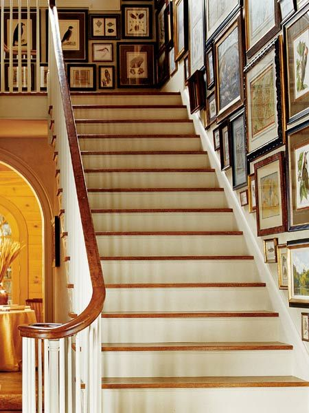 Utilize an empty space to showcase a collection. This stairway is home to framed maps and nature prints. (Photo: Photo: Jeff McNamara; Designer: Mark Maresca)