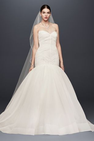 Zac Posen's signature couture craftsmanship is highlighted in this draped organza trumpet wedding dress. The drop-waist bodice is defined by angular pleats and satin seaming and leads to a soft trumpet skirt finished with structured horsehair trim.   Truly Zac Posen, exclusively at David's Bridal  Polyester  Chapel train  Back zipper; fully lined  Dry clean  Imported Also available in extra length