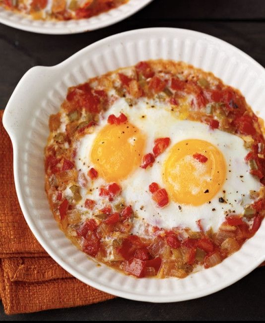 These Havana-style Cuban eggs are baked in a thick, savory sauce of peppers and tomatoes, topped with butter and a heady drizzle of sherry.