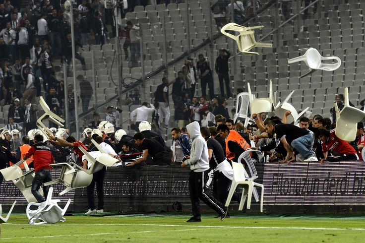 FIELD FRACAS: Fans fought with police during a match between Besiktas and Galatasaray, both Turkish soccer teams, at Ataturk Olympic Stadium...