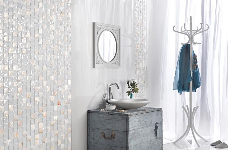 Add a glint of sparkle in an all white bathroom with Mother of Pearl mosaic.. For the latest collections and designs for all styles and budgets visit one of our Yorkshire showrooms. #tiles #tiling #ideas #inspiration #mosaic #pearl #white #bathroom