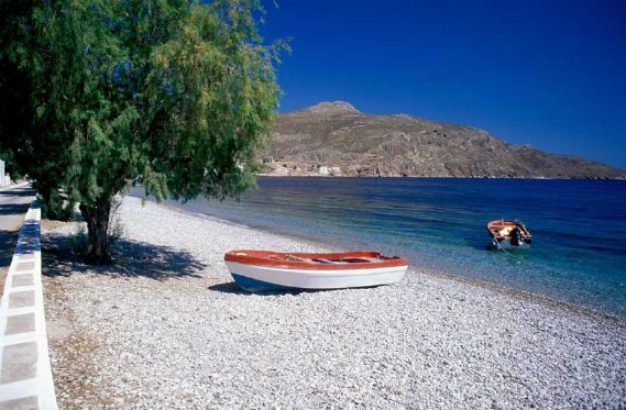 I'm a lonely boat! The deep blue waters of Livadia, in Tilos island, Greece.