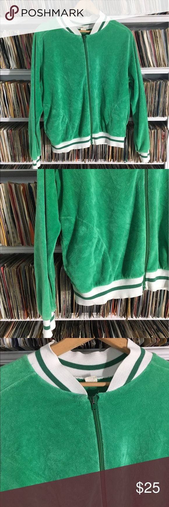Vintage track suit tennis velour jacket This is an awesome simple track suit jacket. It's the ultimate accessory with a pair of jeans or cute shorts on a cool day. It's a size large. It's in good condition. Please understand with all vintage clothes small imperfections may exist that were not initially detected. Vintage Jackets & Coats