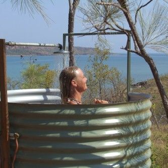 Shower in the great outdoors with 180-degree views of the Timor Sea - at Faraway Bay, The Bush Camp, in Australia's far north Kimberley.