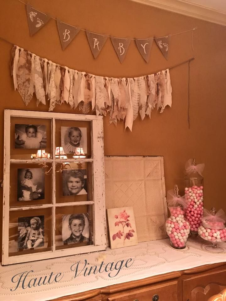 Dessert table for a Vintage, Shabby Chic Baby Shower.  The use of an antique Window with the mom and dads photos, lace bunting, a vintage ceiling tin and some pearls...