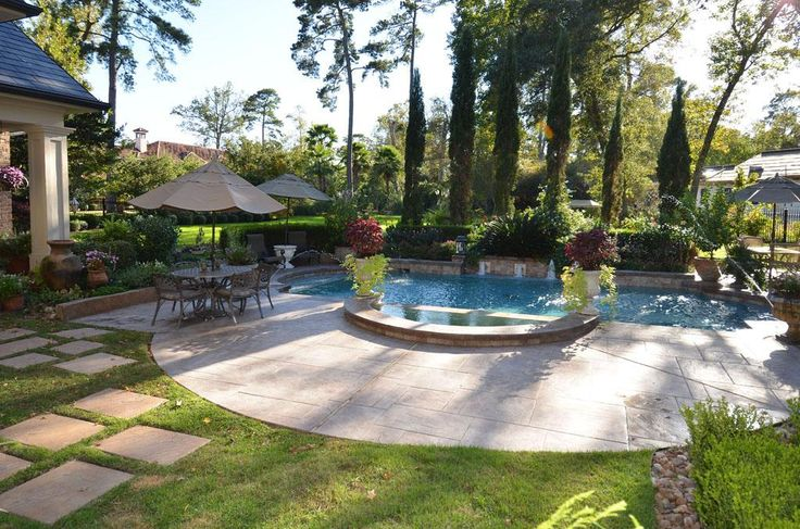 Pool in the backyard of a beautiful french country home for Country pool ideas