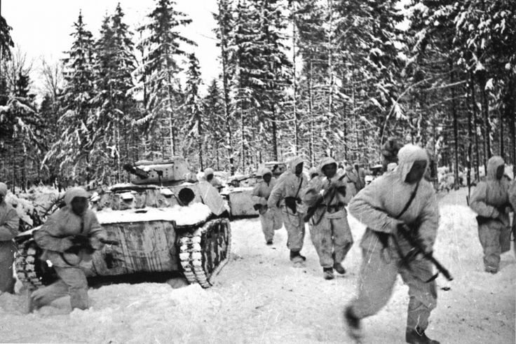 Soviet submachine and a column of light tanks T-40 in winter forest during the Battle of Moscow.