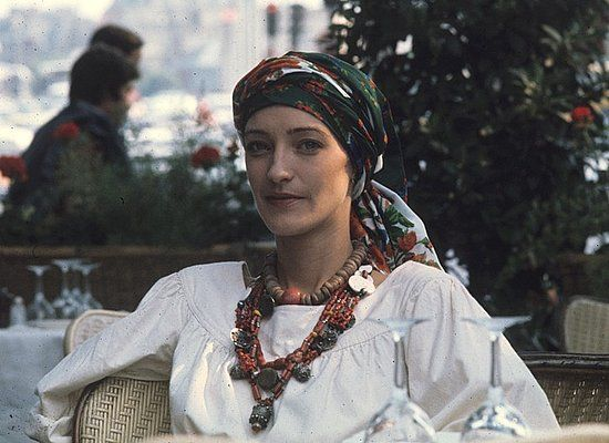 Loulou de la Falaise wearing a treasured necklace given to her by Pierre Berge and Yves Saint Laurent. Photo by Guy Marineau. W, June 1976.