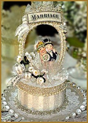 little cuties 1920 style cake topper. Use an old valentine and PILES of glitter!