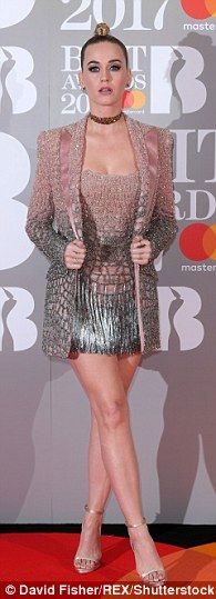 Glitzy: The American songstress dazzled in the lavish co-ords which were embellished with silver sequins and fine tassels