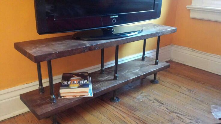 Industrial TV stand || media console || bookshelf || rustic TV stand || industrial chic furniture || steampunk || steel and wood TV stand by PipeAndWoodDesigns on Etsy https://www.etsy.com/listing/218562624/industrial-tv-stand-media-console