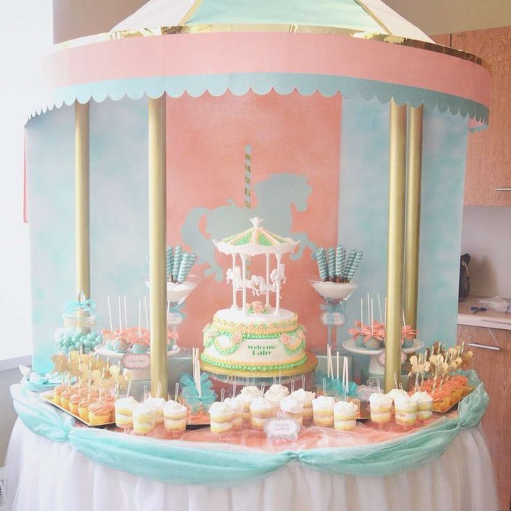 Pastel carousel baby shower party! See more party planning ideas at CatchMyParty.com!