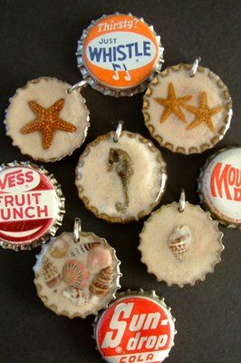recycled vintage bottle cap jewelry made with starfish, seahorses, seashells, sand dollars and sharks teeth set in resin with sand.
