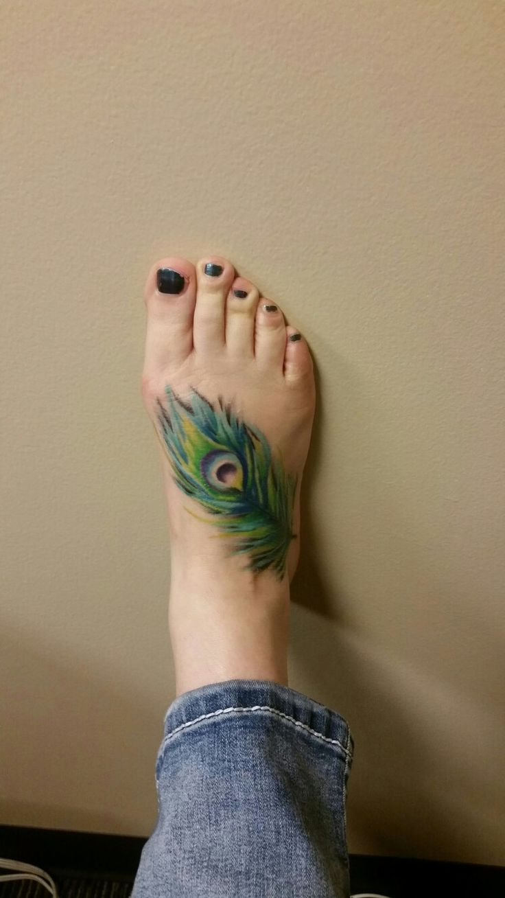 foot tattoo, peacock feather, peacock feather tattoo