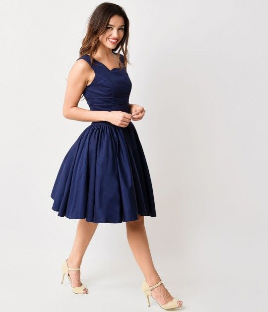 Prepare yourselves dames - a vintage vacation awaits! The rich navy blue Roman Holiday from Unique Vintage is perfectly plucky in a timeless retro dress style, with a dainty scalloped neckline that extends around the V back, creating a delicate feminine d