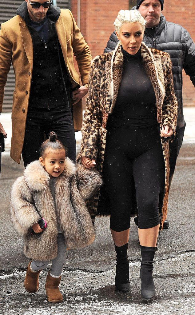 Kim Kardashian's Mini-Me North West Catches Snowflakes on Her Tongue, Wears a Huge Fur Coat   E! Online