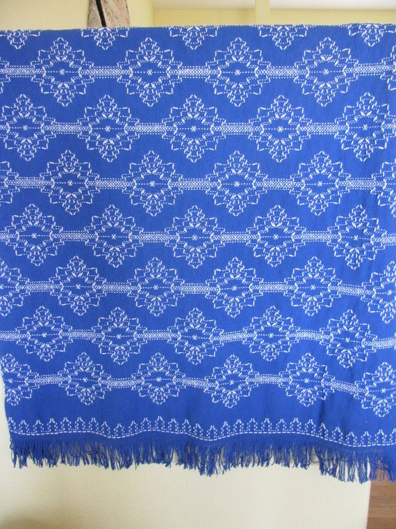 A beautiful blue 100% cotton monks cloth blanket woven in Swedish Weaving style with white acrylic yarn containing a silver thread will