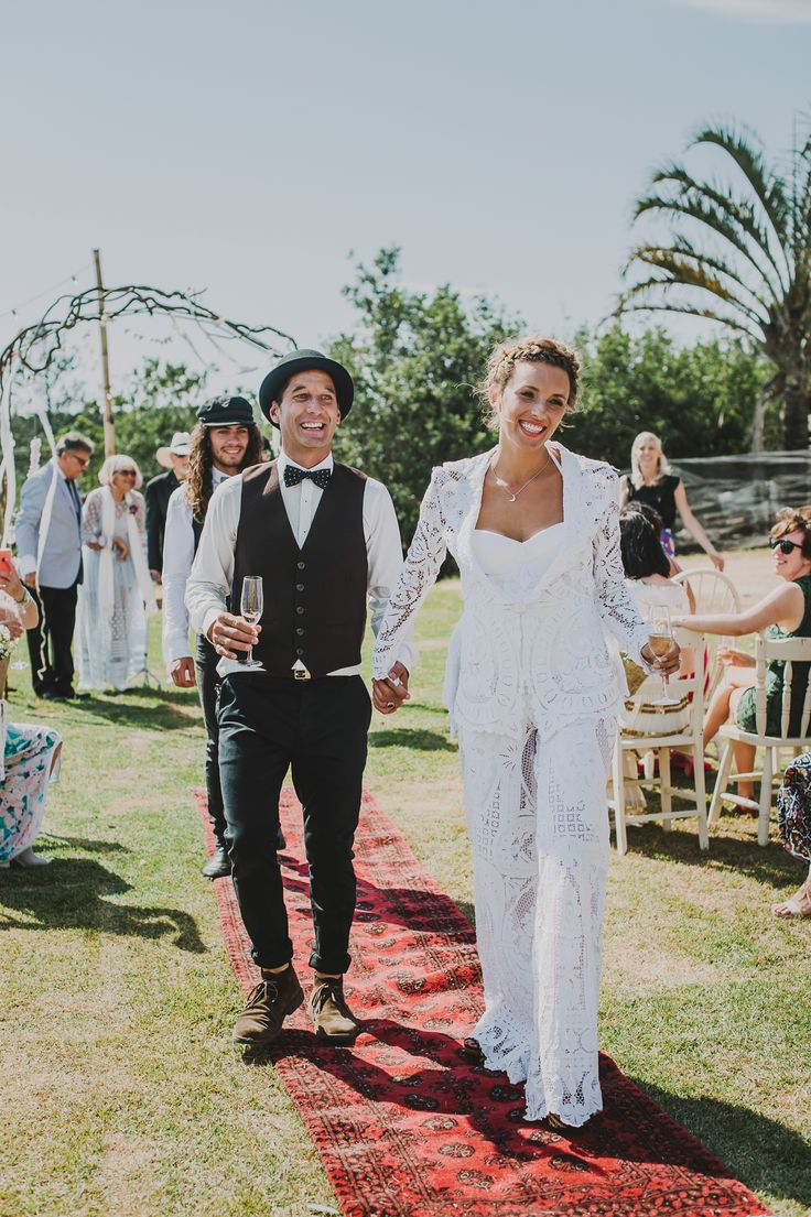 Tiff wore a tailored lace pantsuit and corset for her Byron wedding. The ensemble was cut from an amazing 1900's point de venise banquet tablecloth utilising the lace patterns in the design. The jacket has wide lapels, narrow sleeves, tapered waist & flared peplum at back. Waist is finished with a 1930's feather engraved glass button. Pants have wide full legs  & slant pockets are finished with lace edge. Corset is eyelet pinstriped cotton cut on the bias with appliquéd lace pic: lucy…