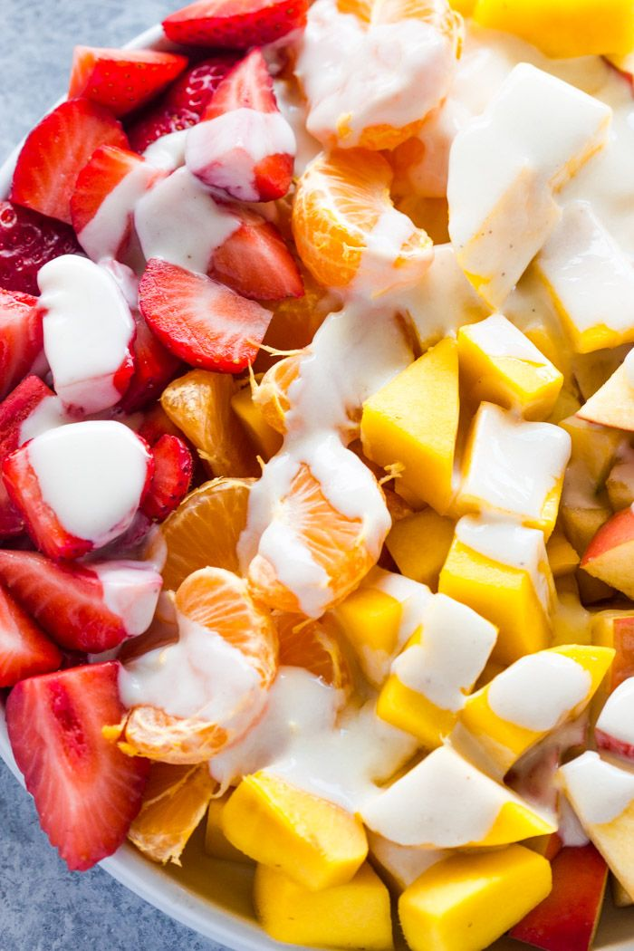 Snack healthier this summer with this fresh fruit salad and creamy skinny healthy 3 ingredient honey yogurt sauce. It's all natural and no sugar. Plus, it's easy to prepare and eat! Wou…
