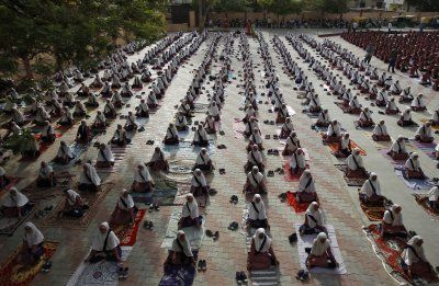 Photos from World Yoga Day 2016: Students practice yoga during a training session ahead of World Yoga Day in Ahmedabad, India.
