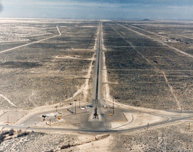 """The High Speed Test Track at Holloman (HHSTT) is not your usual test track used for testing cars. It's what is known as a """"rocket sled"""" consisting of a test platform that slides along a set of rails, propelled by rockets. A rocket sled does not use wheels. Instead, it has sliding pads, called """"slippers"""", which are curved around the head of the rails to prevent the sled from flying off the track."""