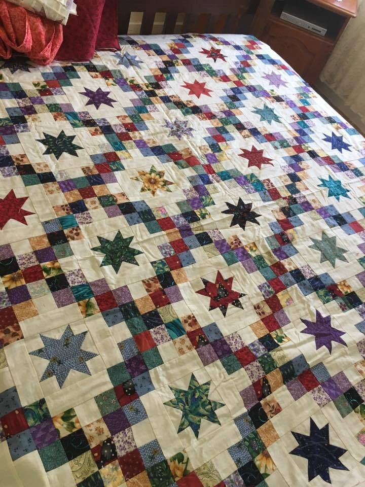 Beautiful scrappy star quilt.
