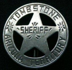 In 1881, Cochise County was formed from the eastern part of Pima County with Tombstone, Arizona as the county seat. Sheriff John Behan, was the first Sheriff of Tombstone and wore a badge matching this reproduction.     Old West Badge-Sheriff Tombstone at CircleKB.com All Western Cowboy