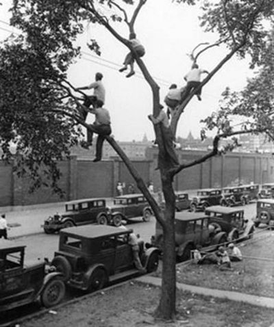 """""""The original rooftop bleachers"""",...on Sheffield St. looking over the right field wall.     c.1932, Wrigley Field, Chicago...lol"""