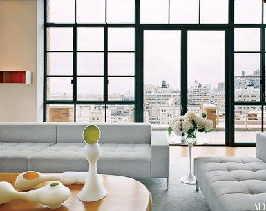 """Like the photography and art collected by the homeowners, the space frames perspective views,"" architect Lee F. Mindel says of a New York penthouse that he designed with Peter L. Shelton. A Donald Judd work is mounted on the living room wall 