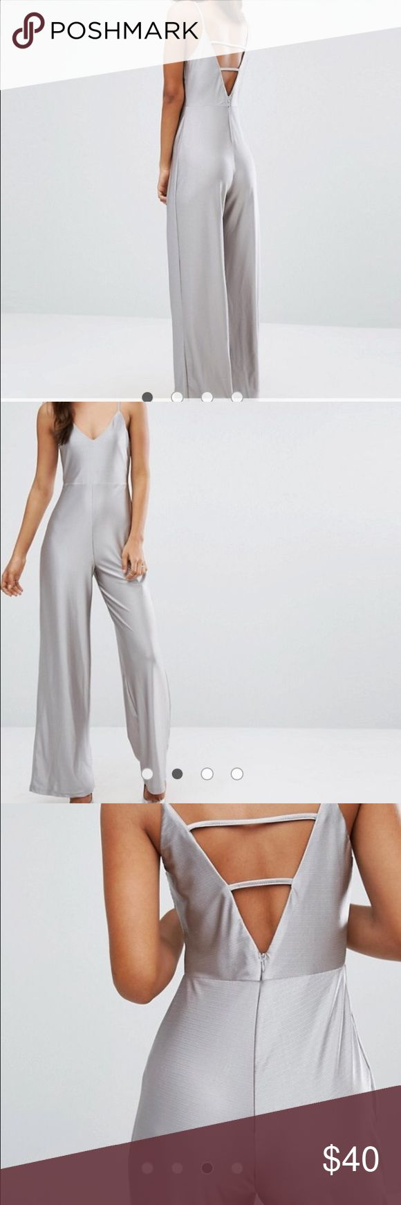 Asos silver jumpsuit My picture doesn't do it justice I put it there so that you can see I actually have it, never worn looks exactly like the picture ASOS Other