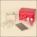 Sonic jewelry cleaner with jewelry tray, touch-up brush, and two delicated jewelry concentrate cleaners.