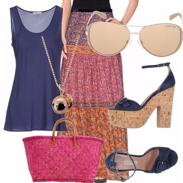 Il classico stile hippy è di tendenza più che mai! Qui si mixano accessori vintage, come il gonnellone a fiori, le zeppe in sughero e la borsa di paglia che dà un tocco in più.