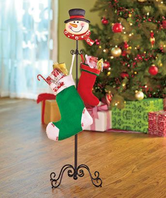 Standing Holiday Stocking Holder is a fresh and adorable way to display your family?s stockings. This metal stand with scrolled base and painted character head is a decorative alternative to hanging stockings on a mantel. Holds up to 6 stockings with