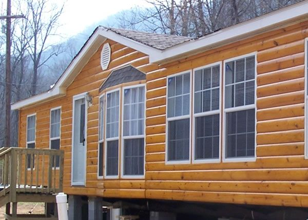 Best 25 log cabin mobile homes ideas on pinterest for Manufactured wood siding
