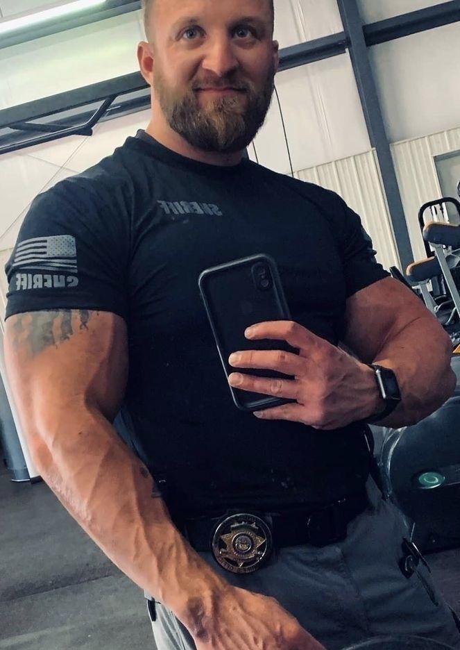 Pin By Beardedbastard On Cops More Lifetime Fitness Men In Uniform Mens Tops
