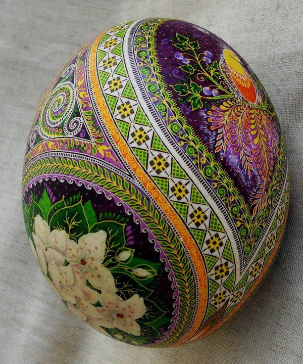 """A pysanka (Ukrainian Easter egg) decorated with traditional Ukrainian folk designs using a wax-resist (batik) method. The word pysanka comes from the verb pysaty, """"to write"""", as the designs are not painted on, but written with beeswax. Artist Ulyana Linda"""