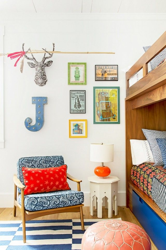 Colorful kids bedroom with a midcentury modern armchair, a bunk bed, and colorful art