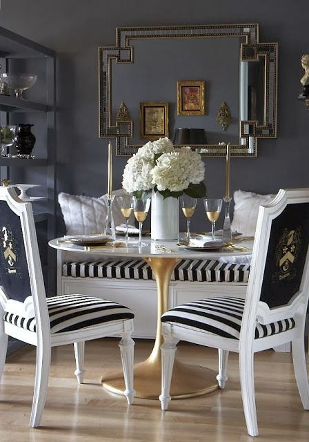 Stunning Dining Room Design With Blue Walls Paint Color Horchow Mosaic Mirror White Banquette Black Stripe Cushion Saarinen Round Marble