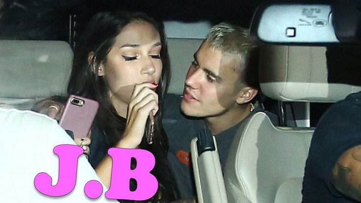 🚕🚕🙈 Justin Bieber cosies up to a mystery brunette in Brazil