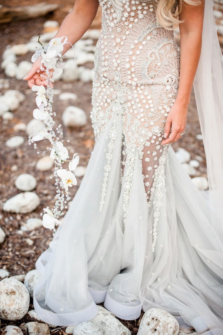 Bride wears a Mermaid Inspired Wedding Dress | Photography by http://www.gypsywestwood.com/