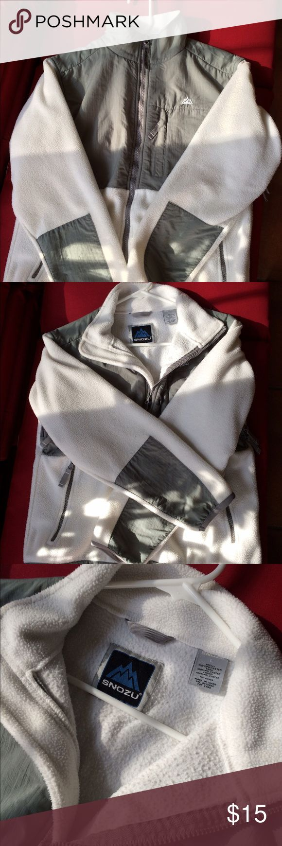 White and grey zip-up fleece. Make an offer on this: Nice Snozu white and grey zip-up fleece with side zip pockets and hidden breast zip pocket. Also has zip vent under both sleeves.  Great to wear alone or as added warmth under a coat. Snozu Jackets & Coats