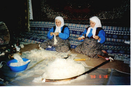 """Turkish Rug Factory...the beginning of the process    June 18, 1998 - This is the Turkish Rug Factory that we visited and learned about the carpet making process that produces the """"most sought after"""" priceless carpets that the world collects.    I was blessed with being able to assist in the weaving process, so somebody's carpet, somewhere in this world, has fibers woven by little ole me in it!    What a process, from the pulling and spindling of the fibers, to the dying vats...all amazing!"""